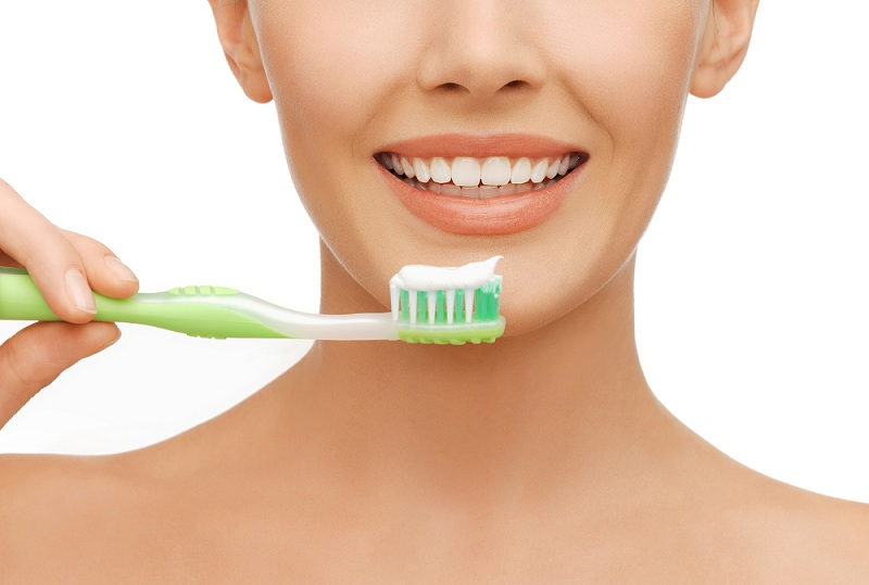 beauty and dental health concept - beautiful woman with green to